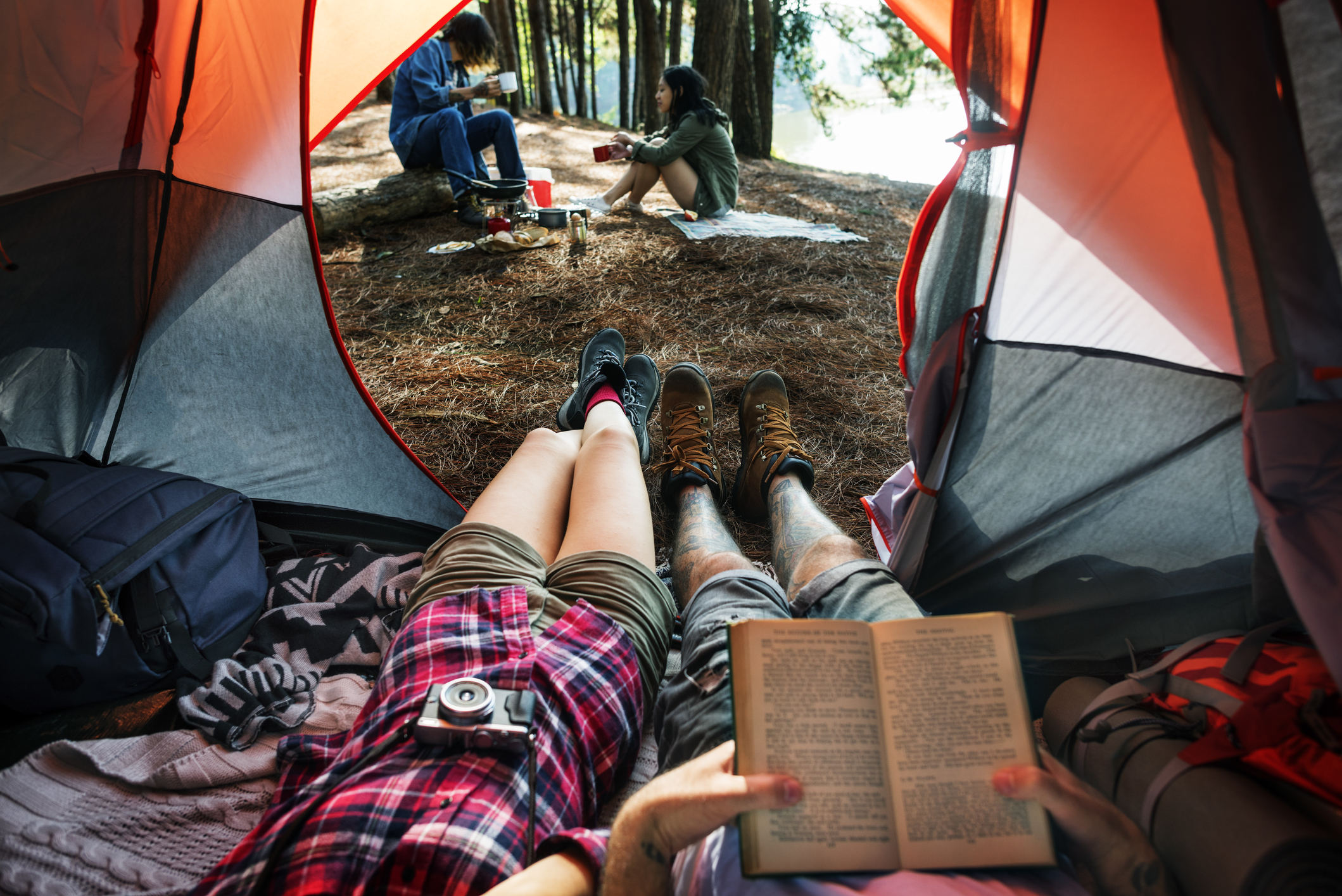 feel out of tent with two people in background