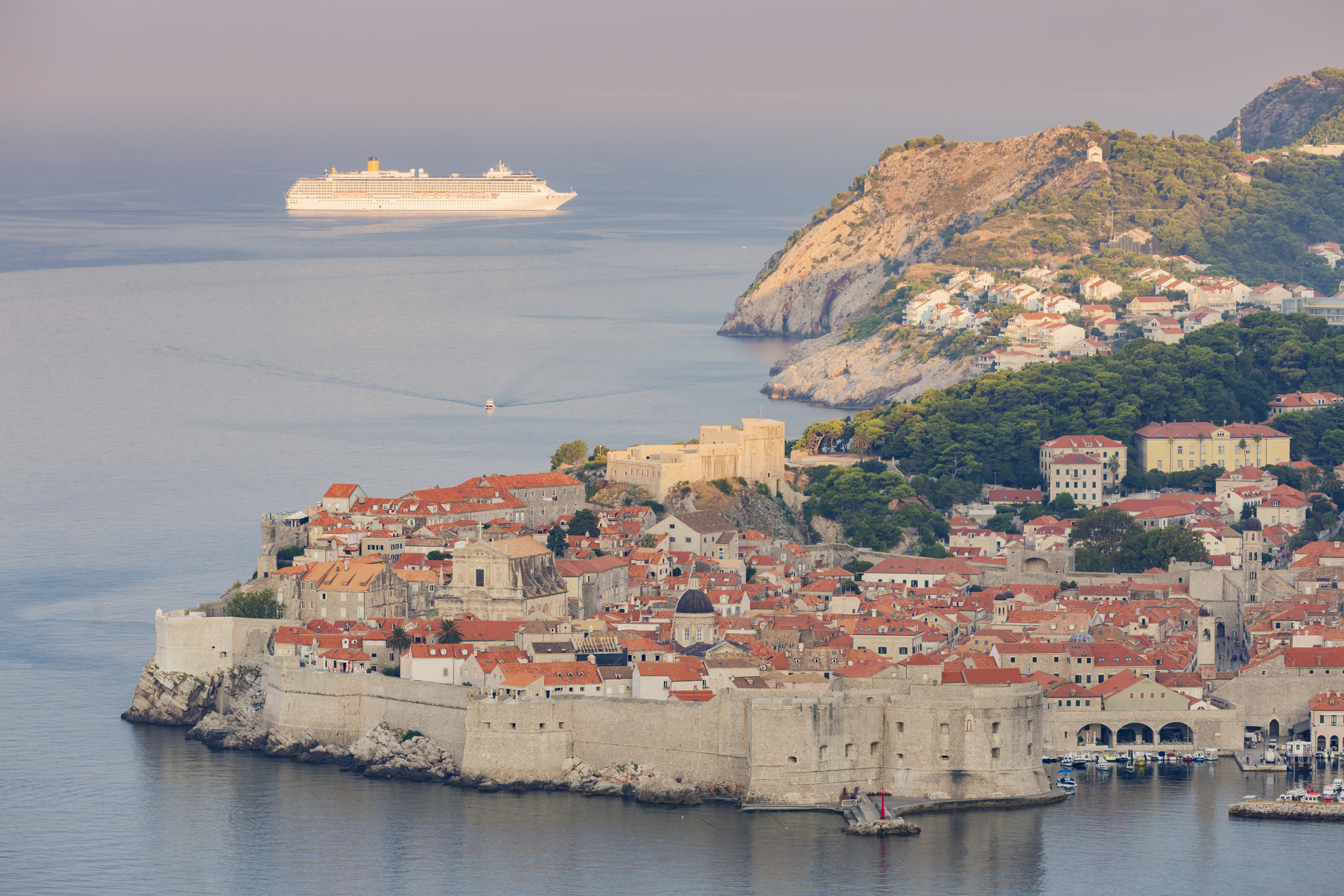 A cruis ship passes in the distance of Dubrovnik's Old Town