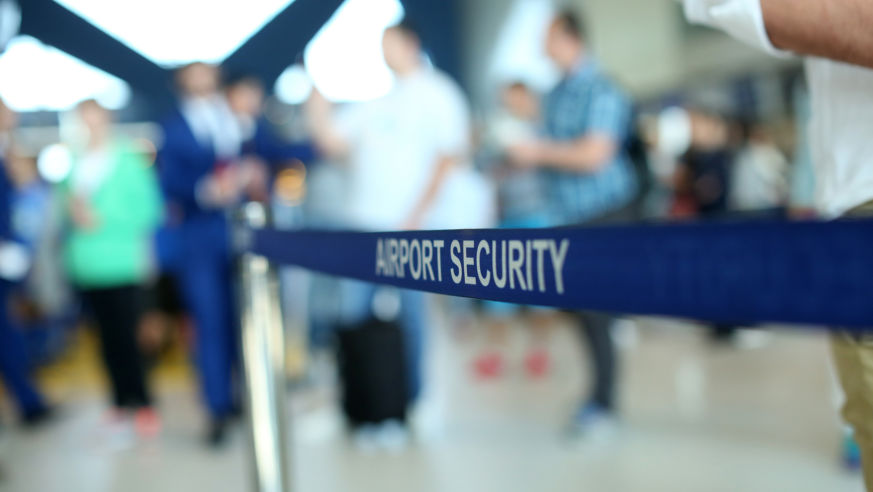 """A sign reads """"airport security"""" at an airport."""