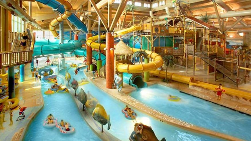 Indoor pool with waterslide  Top 10 Indoor Water Parks in the U.S. | Budget Travel