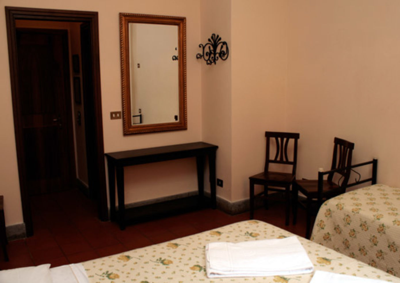 Rooms at Hotel Panda have vaulted wood-beam ceilings, stone-tiled floors, and traditional pull shutters.