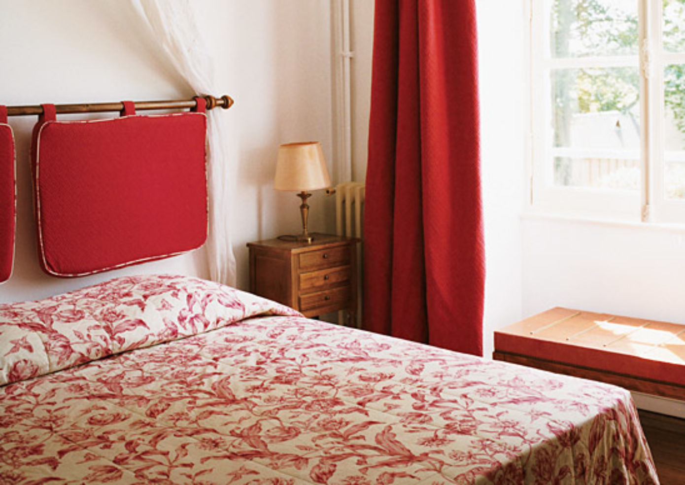 Details like floral fabrics accent the 12 individually designed rooms at Château de l'Isle.