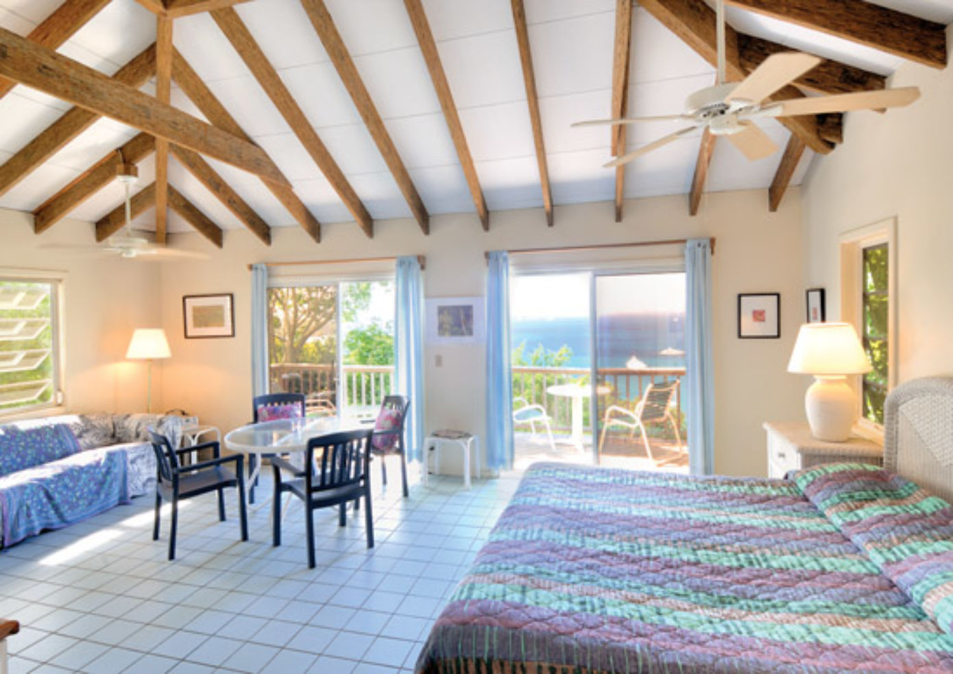 Harmony Studios, 12 airy apartments nearby Maho Bay Camps, have kitchenettes, lofted ceilings, and large decks with water views.
