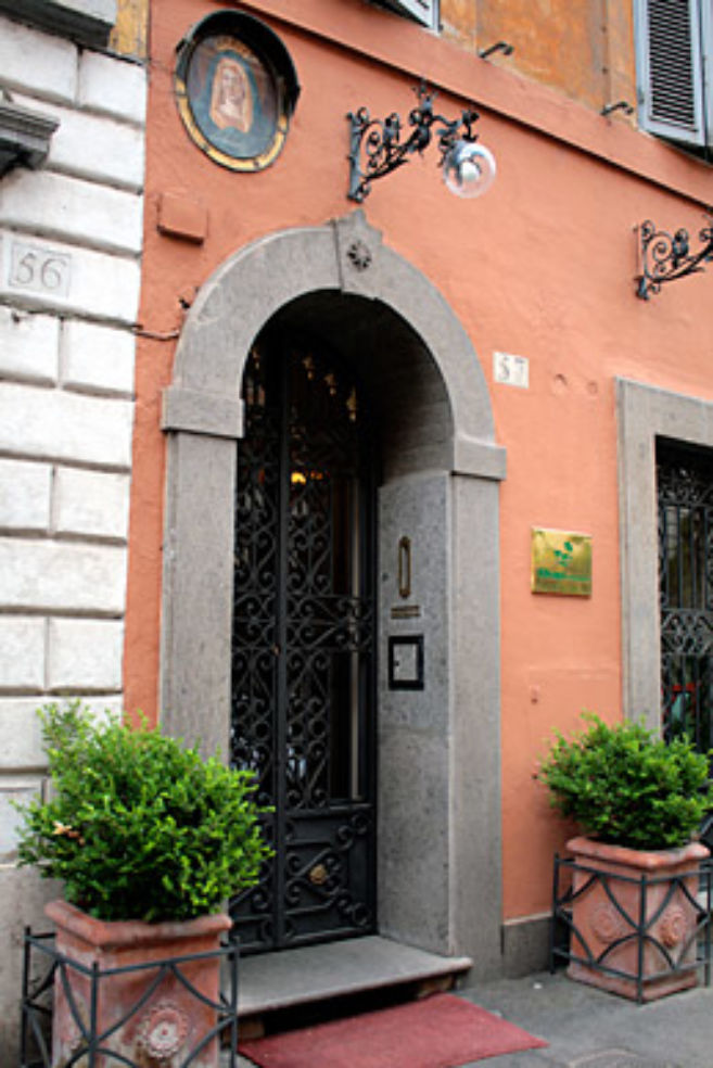 The façade of Okapi Rooms, on a quiet street off Piazza del Popolo.