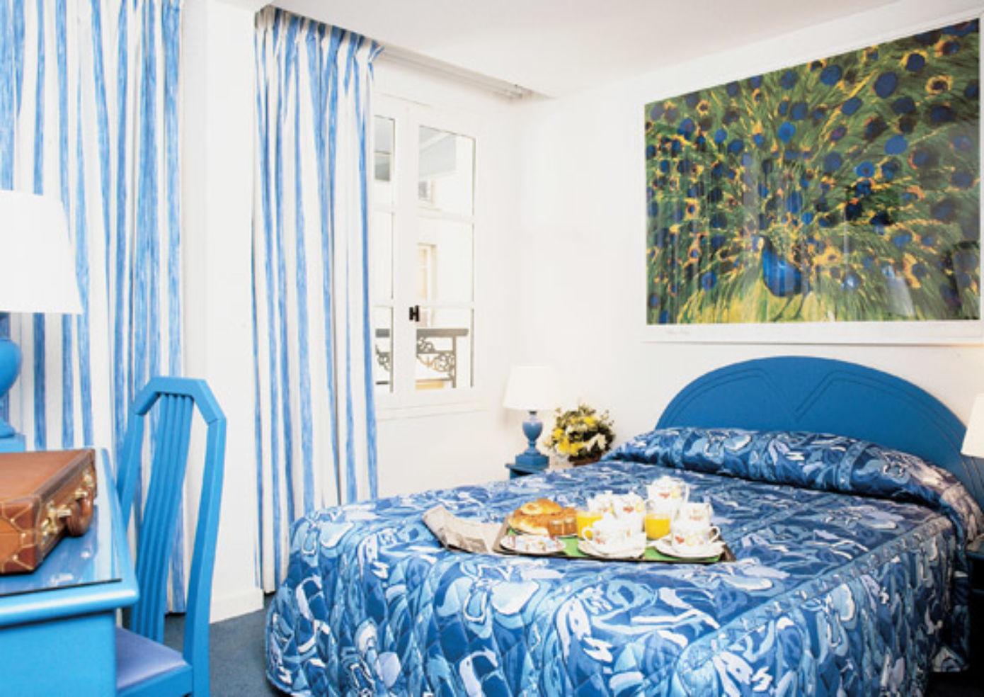 A guest room at the Hôtel Croix de Malte.