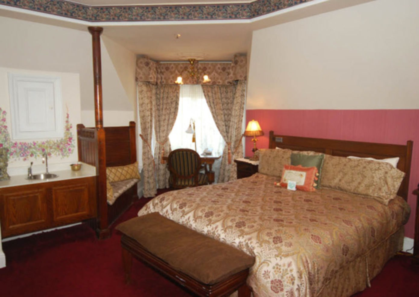 A deluxe room at Queen Anne Hotel