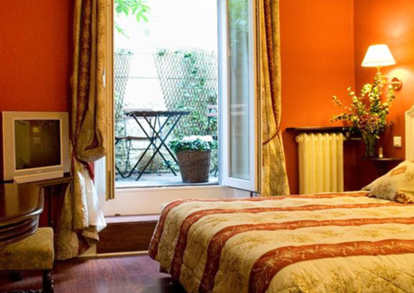A double room at Hotel de la Porte Doree in Paris