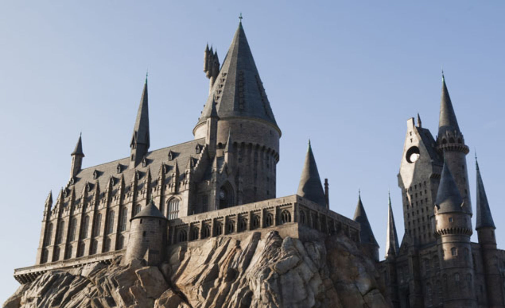 Guests experience the magnificence of Hogwarts castle as it towers above Hogsmeade at The Wizarding World of Harry Potter, only at Universal Orlando Resort.