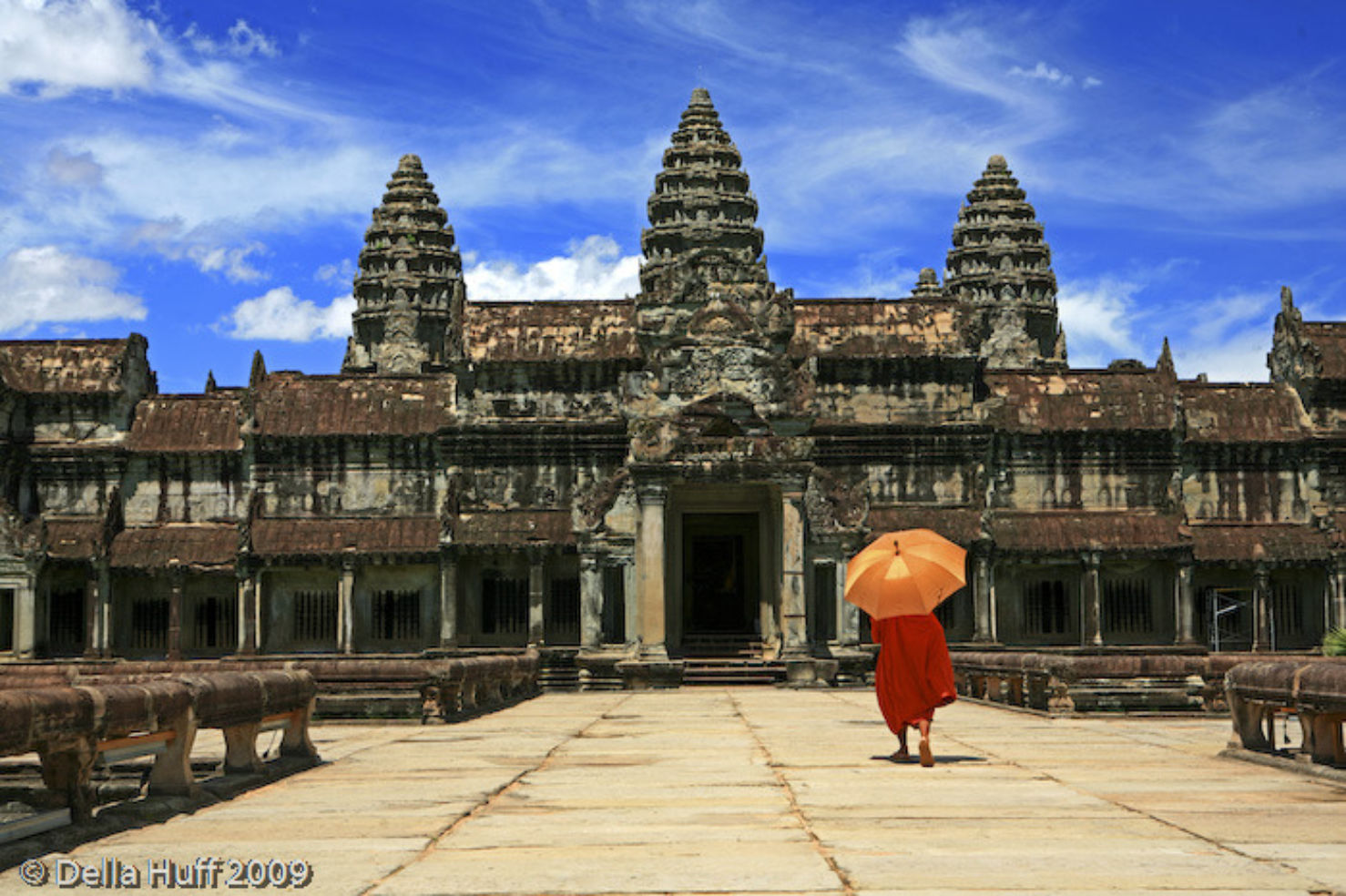 A monk visits the ruins of Angkor Wat in Cambodia.