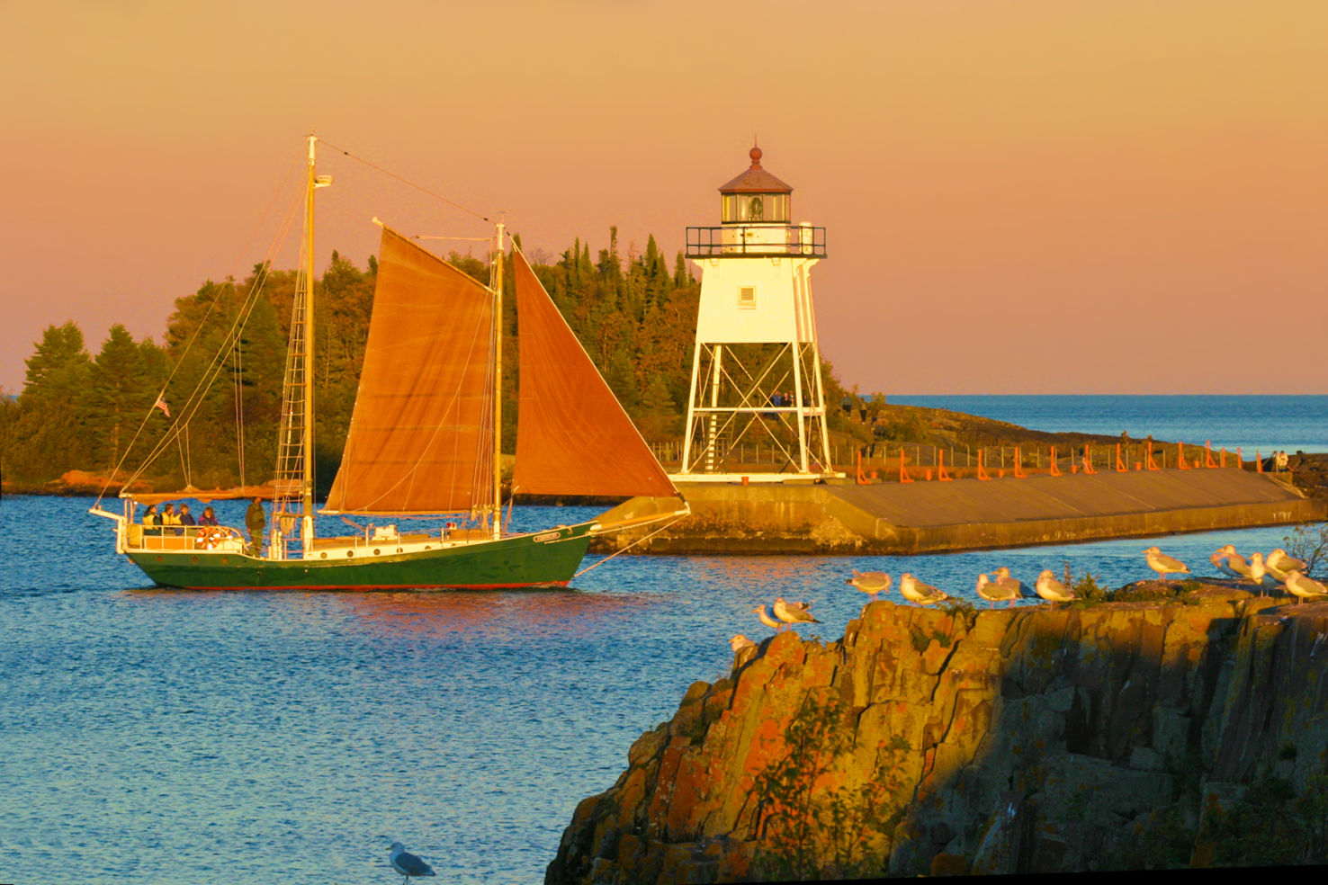 North House Folk Schools sailboat, Hjordis, leaving the harbor in Grand Marais, MN
