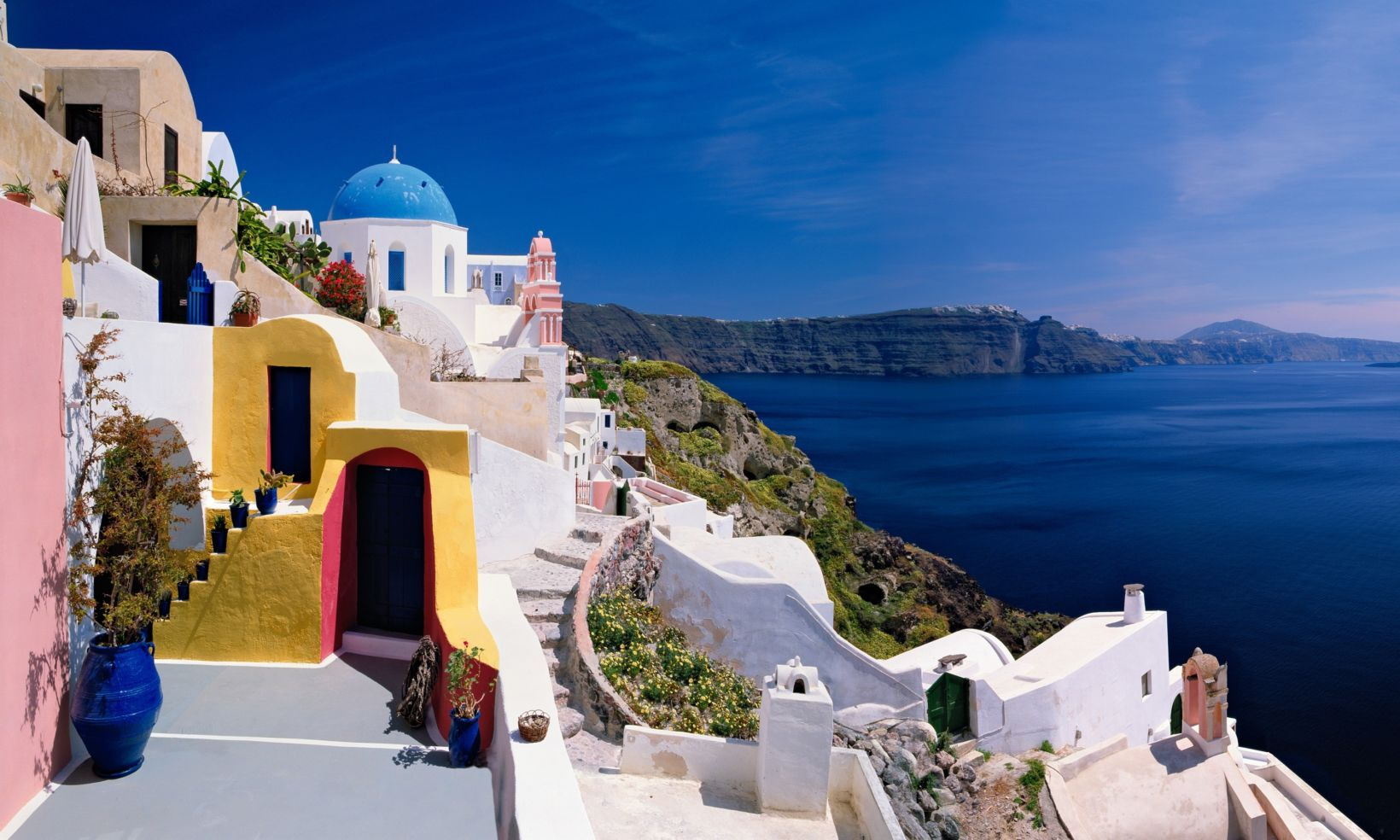 White buildings against the deep blue Mediterranean in Santorini, Greece