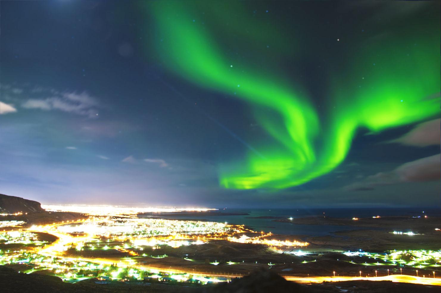 Aurora Borealis above Reykjavik Iceland.