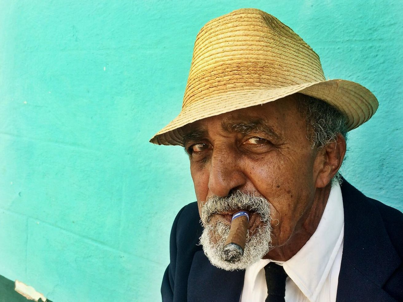man with a cigar and a hat in Cuba
