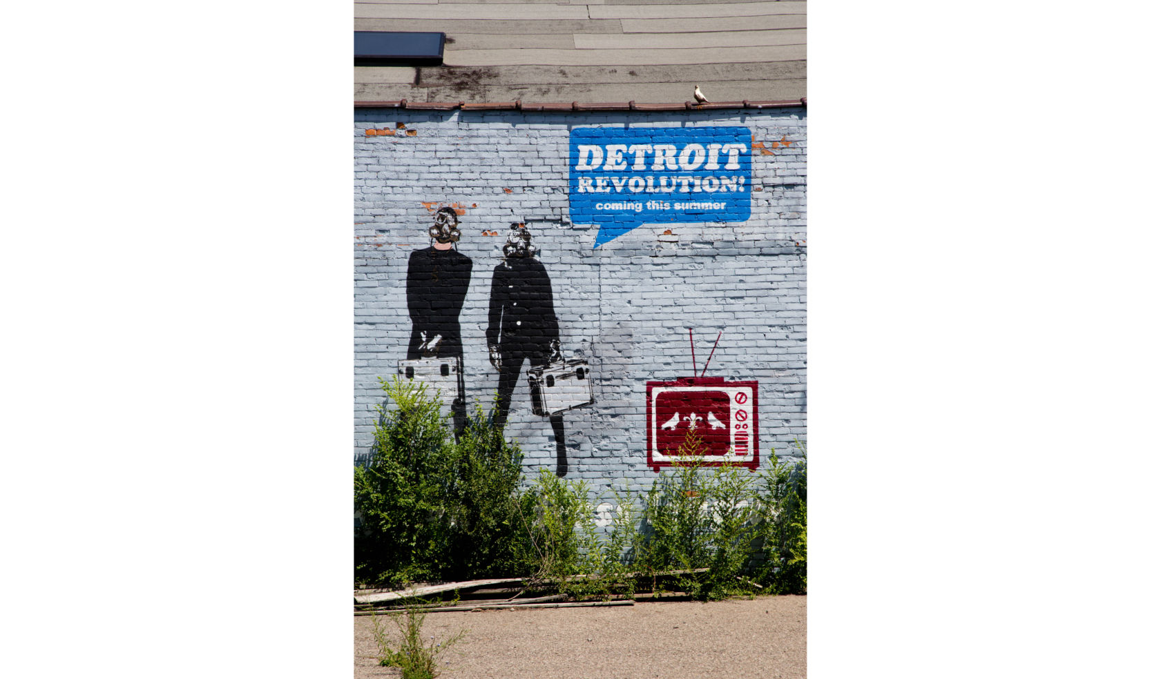 The revolution will be televised, at least according to this street art spotted in a back parking lot in Midtown Detroit.