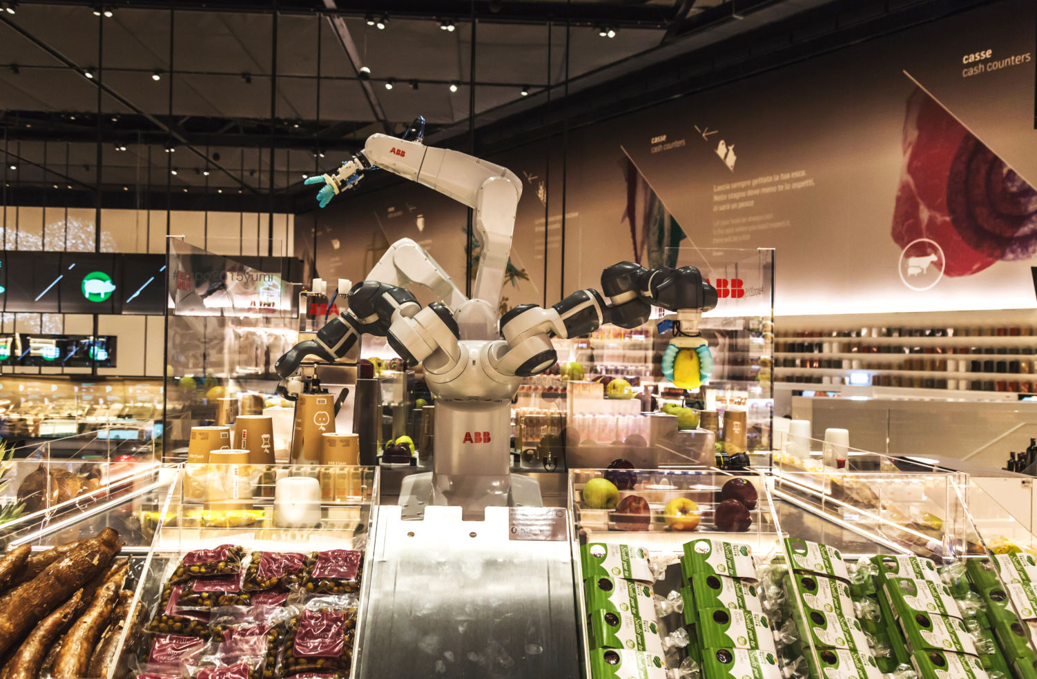 Robotic arms inside a futuristic supermarket Milan Expo 2015