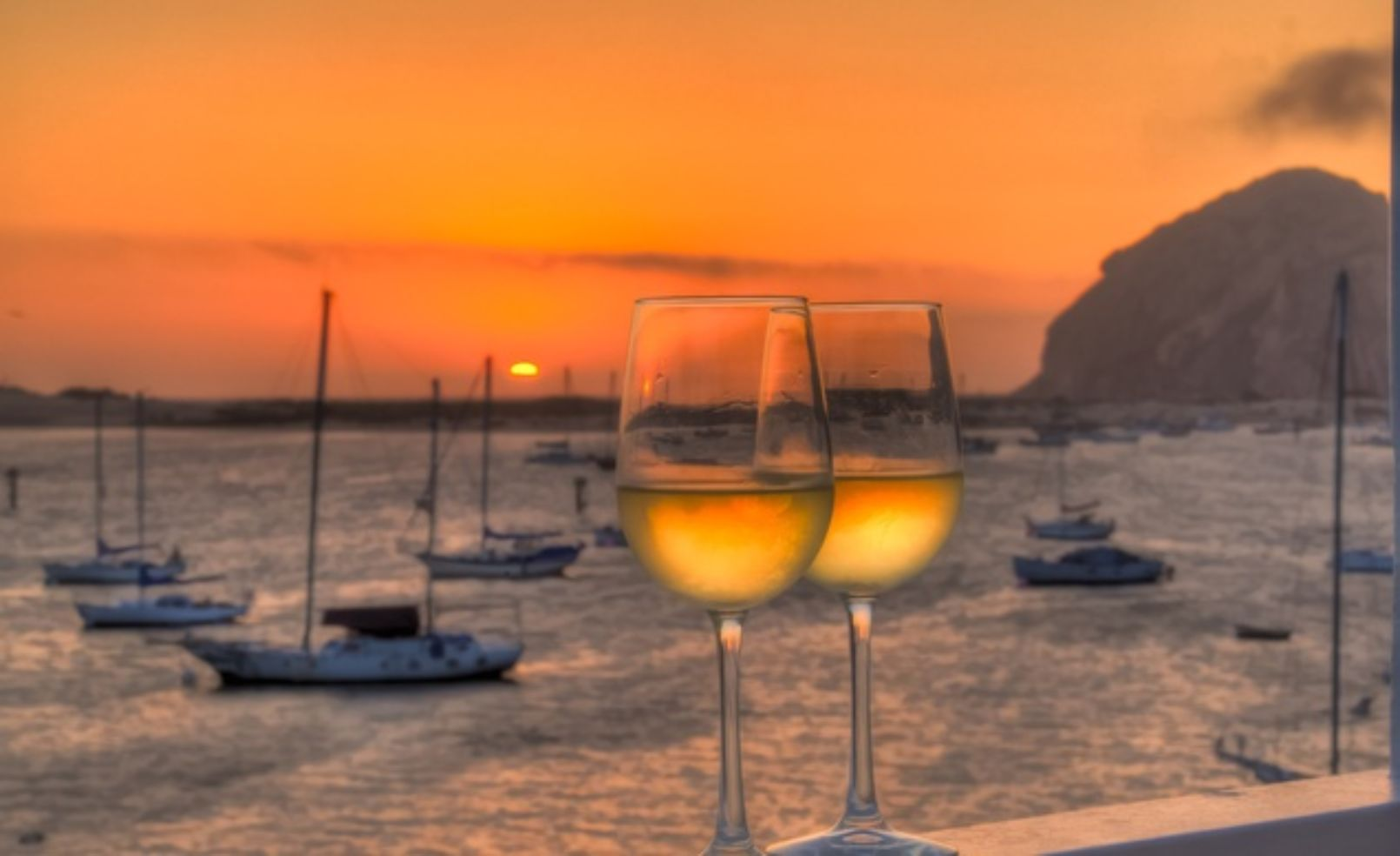 A glass of wine at sunset.