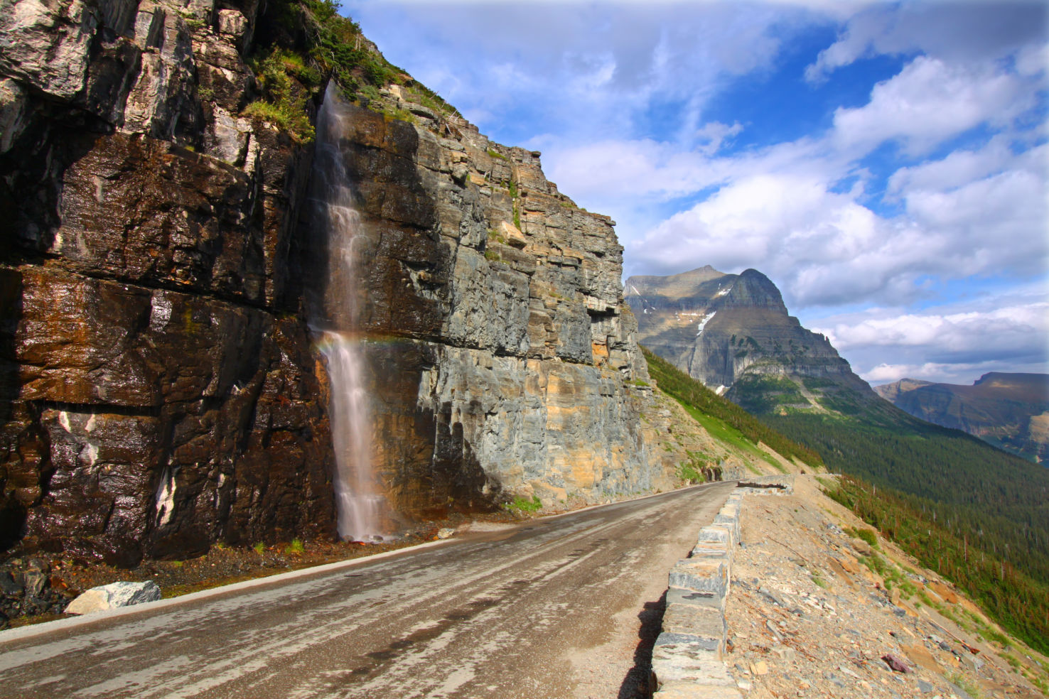 Waterfall flowing onto the Going To The Sun Road - Montana