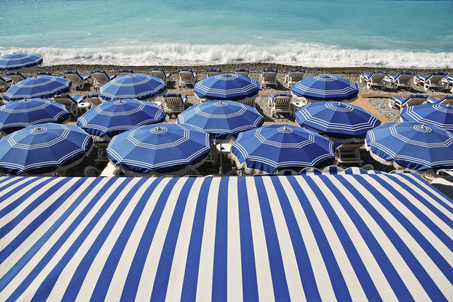 Umbrellas on the beach in Nice, France