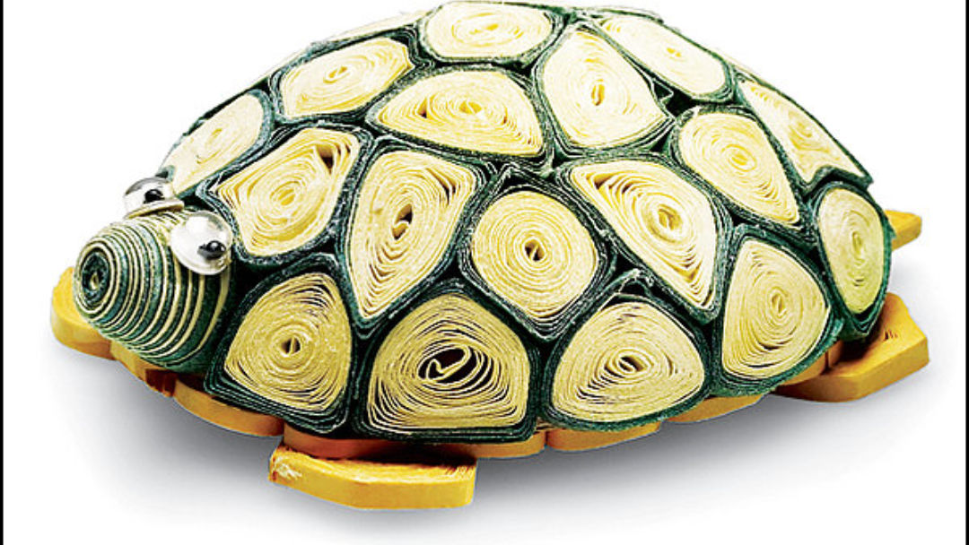 Kết quả hình ảnh cho It takes about three hours to handcraft a 2.5-inch-long turtle, using tiny pieces of rolled-up paper and glue in a process known as quilling—a centuries-old European pursuit