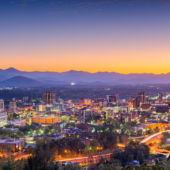 asheville skyline at dusk, mountains in background