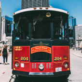 Red Chicago Trolley car on street