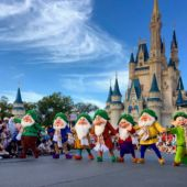 Seven Dwarfs perform with castle in background