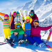 Happy Family on Mountain top skiiing
