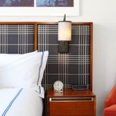 Bed and side table Godfrey Hotel