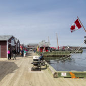 pier on a sunny day with crowds and canadian flag