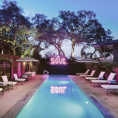 pool at dusk with SOUL neon light sign