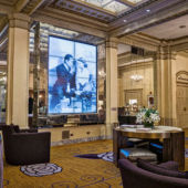 Lobby of hotel with TV screen