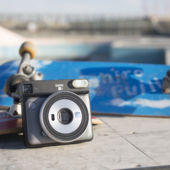 Instant camera by skateboard