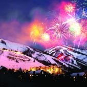 fireworks over town in mountains