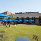 Green lawn with food court in background