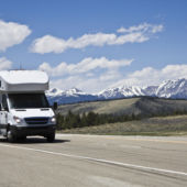 View of a highway in the Colorado Rockies with an RV.