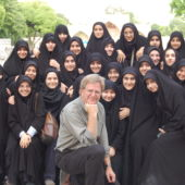 Rick Steves poses with veiled women in Iran in 2008.