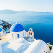 Blue Waters And Domes Of Santorini