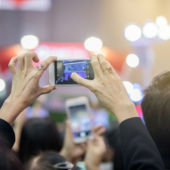 woman using camera phone at show