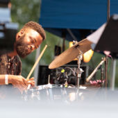 A jazz drummer play9ing at the Charlie Parker Jazz Festival in NYC