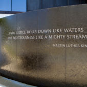 A view of the Civil Rights Memorial in Montgomery, Alabama, with a quote from Martin Luther King Jr.