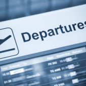 A departures sign in an airport