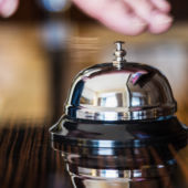 hand about to ring concierge bell