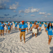 A view of participants on Ft Myers Beach, FL, forming a human seashell