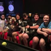 Moviegoers pose with their dogs at K9 Cinemas.