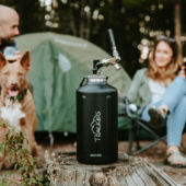 small keg at campsite people and dog