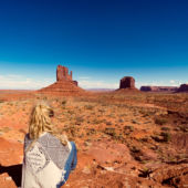 woman alone looking out at monument valley