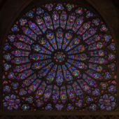 A view of a large stained-glass rose window at the Cathedral of Notre-Dame, Paris.