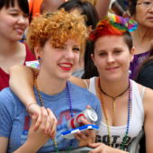 NYC Pride Parade, two women watch
