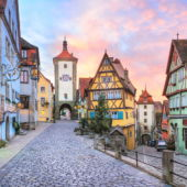 A view of the charming town square of Rothenburg, Bavaria, Germany, with clock tower and medieval buildings.