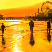 View of the sun setting behind Santa Monica beach and pier